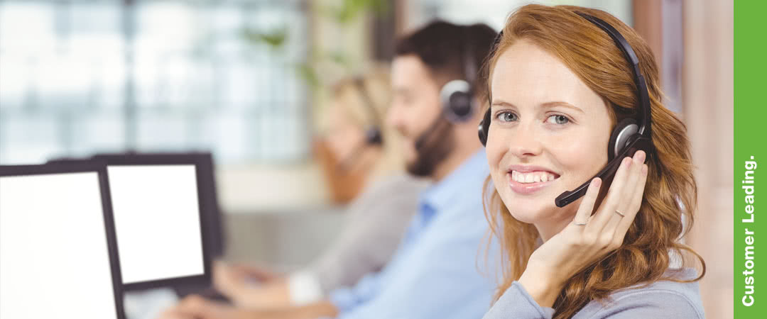 woman with background out of focus using headset