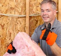 builder installing a pink batt