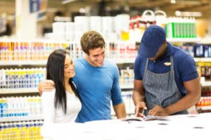 couple in a hardware store looking at product images
