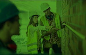 builders measuring a wall - green