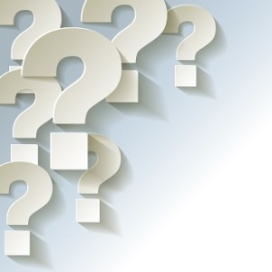 Seven question marks on a grey background