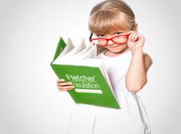 small girl holding a fletcher insulation book