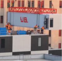 UB printed on a shipping container suspended in the air