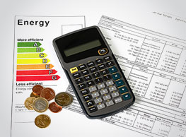 calculator, coins and and energy bill image