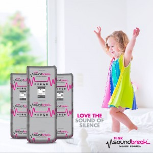 pink sound break- accousitc insulation written on the wall with a child on a bed