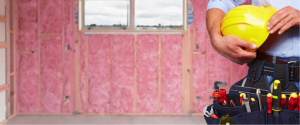 Builder with wall insulation in the background
